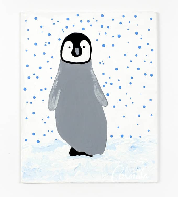 Winter is the perfect season to create Footprint Penguin art with acrylic paint, canvas, and a cozy sock-covered foot from a child you love.