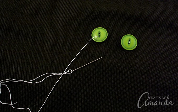 Sew on the green buttons for the yes on your kitty cat tote bag