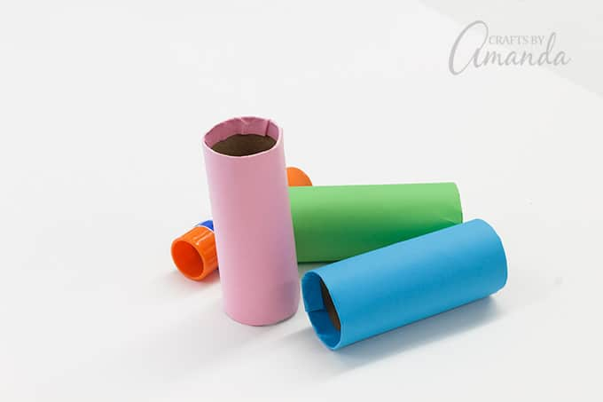 Repeat this step with the pink and green papers on the remaining two tubes.