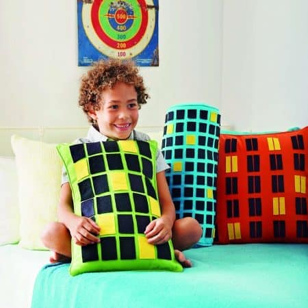 Graphic and bold, this easy-to-make throw pillow can double as a backdrop for imaginative play.