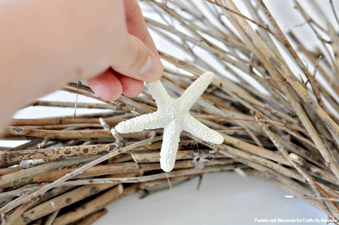 adding starfish to the wreath