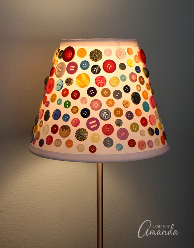 Lampshade with buttons on it