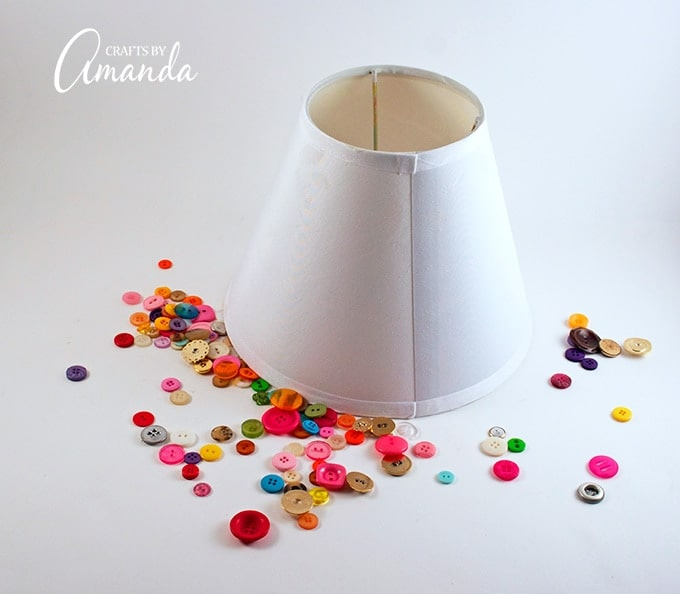 Lamp shade and colorful buttons surrounding it