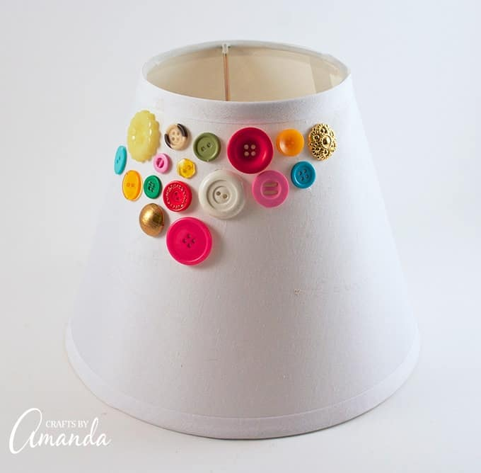 Apply hot glue to your button lamp shade