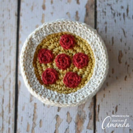These Crochet Pizza Coasters are the perfect summer or spring adult craft. Keep these coasters handy for when you have an ice cold drink on a sunny day!