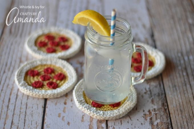 Glass of water on top of crochet pizza coasters