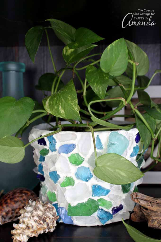 Planter with sea glass and clay with plant inside
