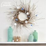 This DIY Coastal Wreath is made from the twigs and seashells you'll find on the beach this summer.