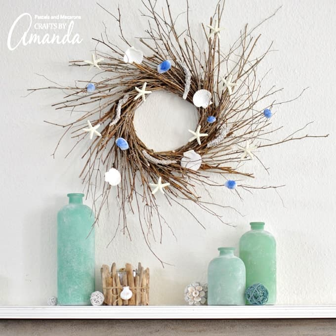 Coastal twig wreath with starfish and seashells hanging on the wall