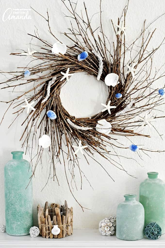Coastal twig wreath with seashells and starfish hanging on the wall