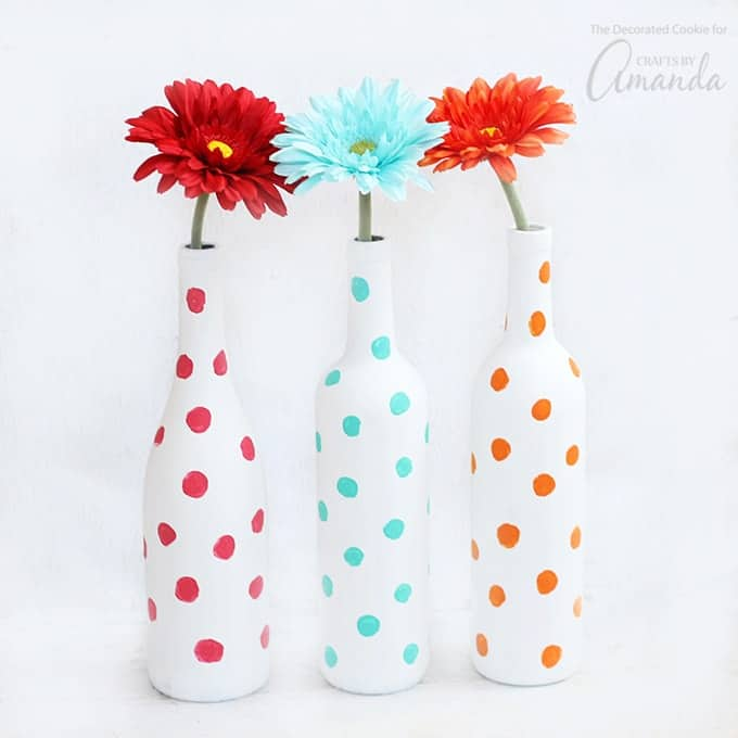 colorful polka dot painted wine bottle vases with flowers