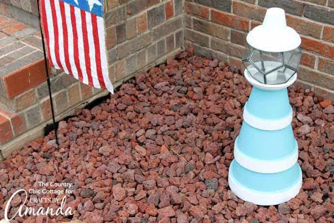 Terra cotta pots painted and stacked to make a lighthouse