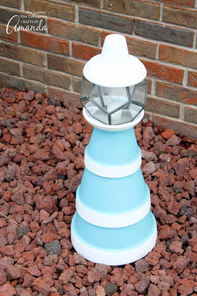 clay pot lighthouse craft in garden