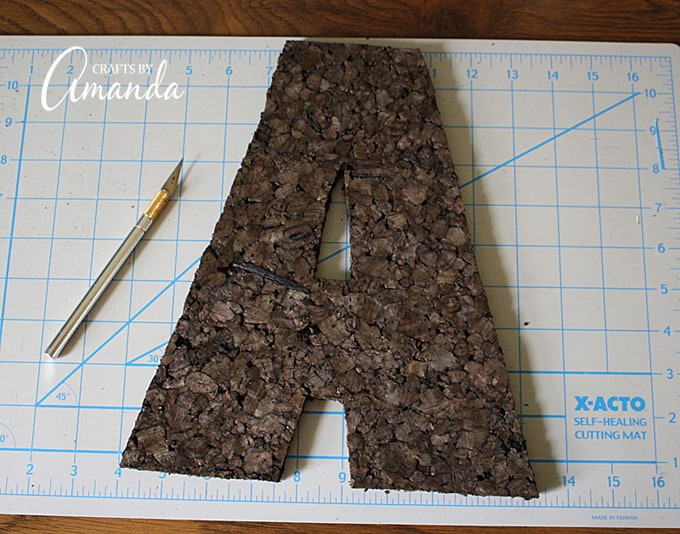 Once you've finished cutting out the letter, trim any jagged or lumpy edges with your craft knife.