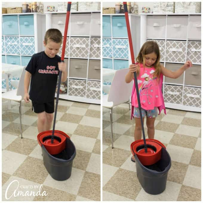 Kids using a mop to clean floor
