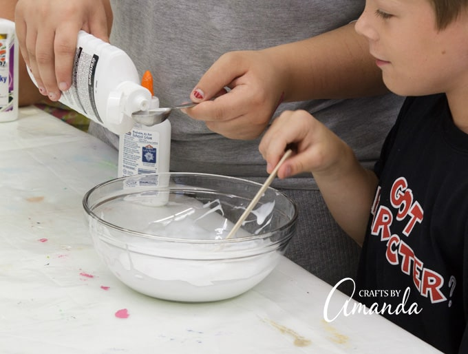 "Add starch, one teaspoon at a time, stirring after each addition. You will notice the glue getting thicker with each addition. Add enough to get the ""slime"" to come together and pull away from the sides of the bowl."