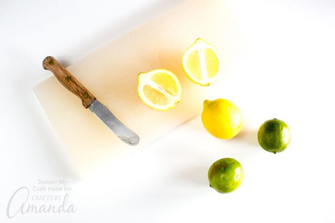 cut the lemons and limes in half