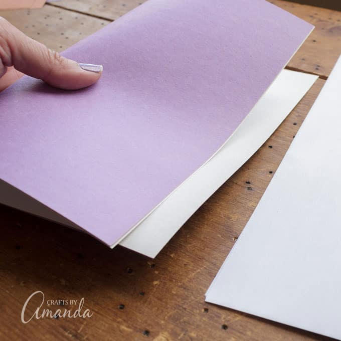 For Surly, take a sheet of purple and a sheet of white construction paper.