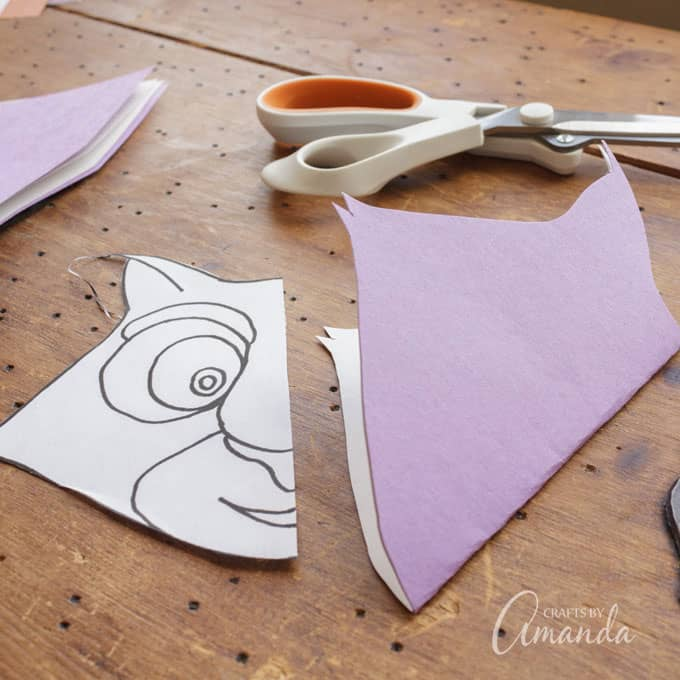 CUT along the lines of the OUTSIDE of the pattern only, cutting through both sheets of construction paper.