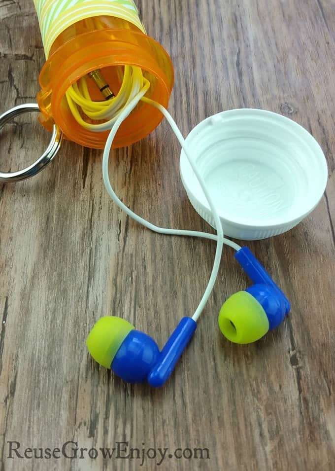 Protect your earbuds and charging cords and prevent tangling by folding them into an old pill bottle.