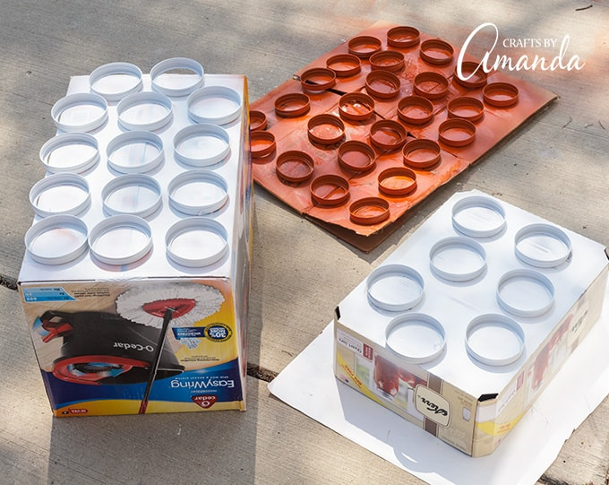 Spray painting canning lids to make mason jar lid pumpkins