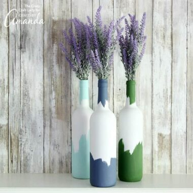 Painted wine bottles make a perfect vase or centerpiece for flowers. Recycle your empty wine bottles, and make this simple craft in no time!