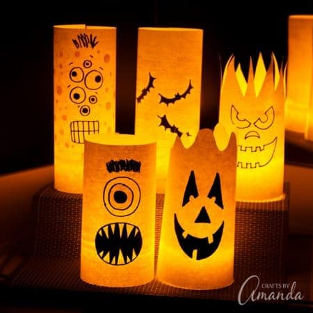 By day they are colorful shelf or window decorations, but by night they are spooky paper Halloween luminaries! Easy to make and fun to look at!