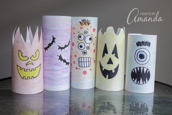 Colored paper luminaries drawn into monsters
