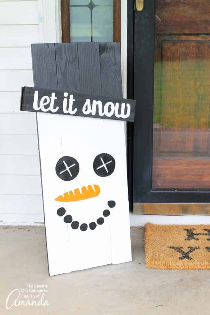 Snowman side of scarecrow sign