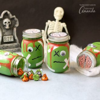 Fill these zombie mason jars with toys for a candy-free Halloween party favor. Or, just use them to decorate your house for Halloween!