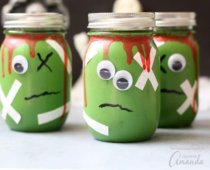 Mason jars painted as zombies for Halloween