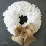 Learn how to make a simple doily wreath. Customize this paper wreath with different bows or decorations, and watch your wreath last all year long.