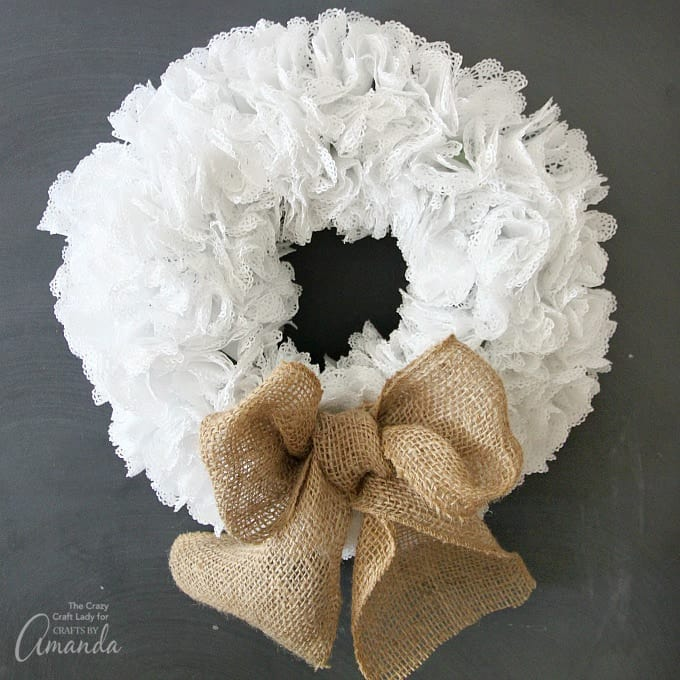 Wreath made out of doilies with burlap bow