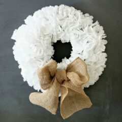 Learn how to make a simple doily wreath. Customize this paper wreath with different bows or decorations, and watch your wreath last all year long. #doilycraft #doilies #easycrafts #diywreath #wreath #adultcrafts #homedecor #diyhomedecor #doily #craftsforseniors