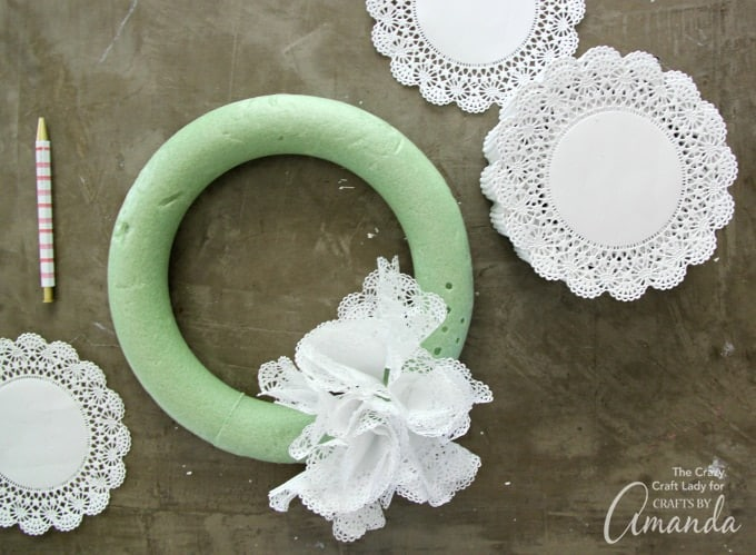 Hot gluing doilies to wreath form