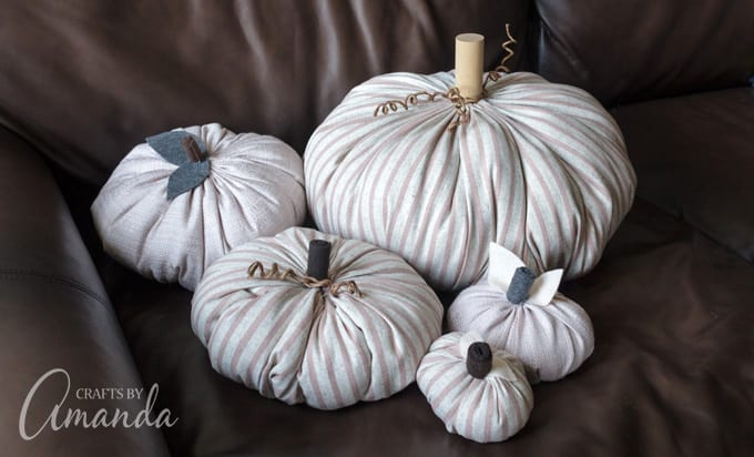 a bunch of fabric pumpkins