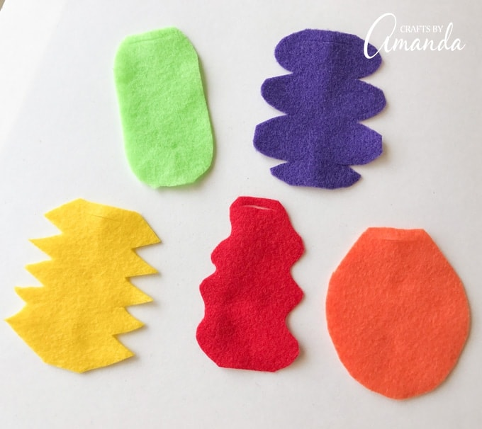 Cut around the edges of the felt to create fun shapes for the monster costumes.