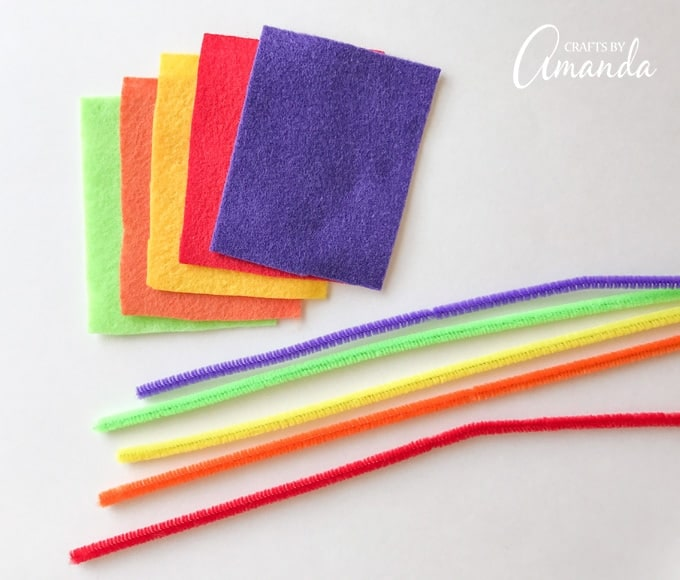 Colorful felt and twist ties for making plastic spoons monsters