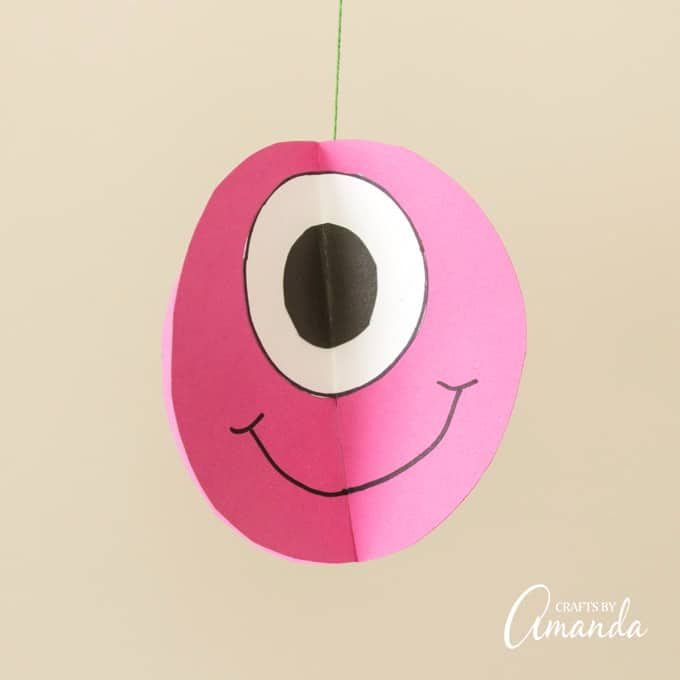 Pink paper twirling monster