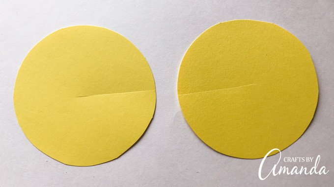 First, cut two large circles from the same color card stock.