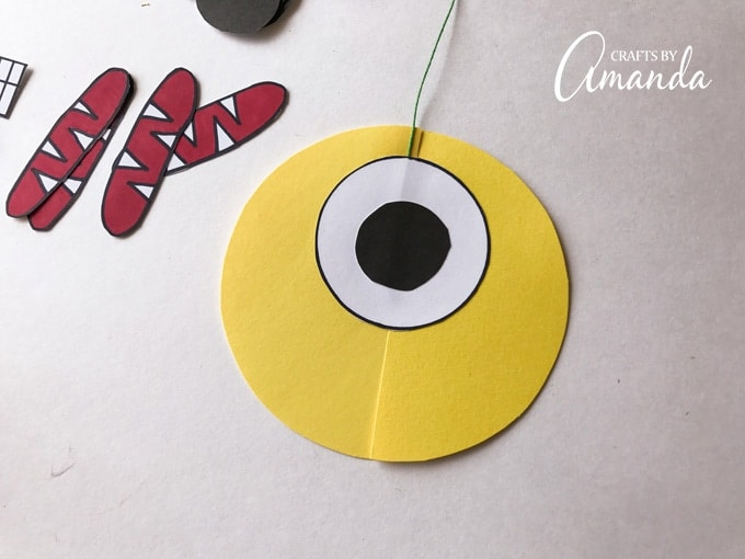 Now glue a small black circle in the center of the medium white circle.