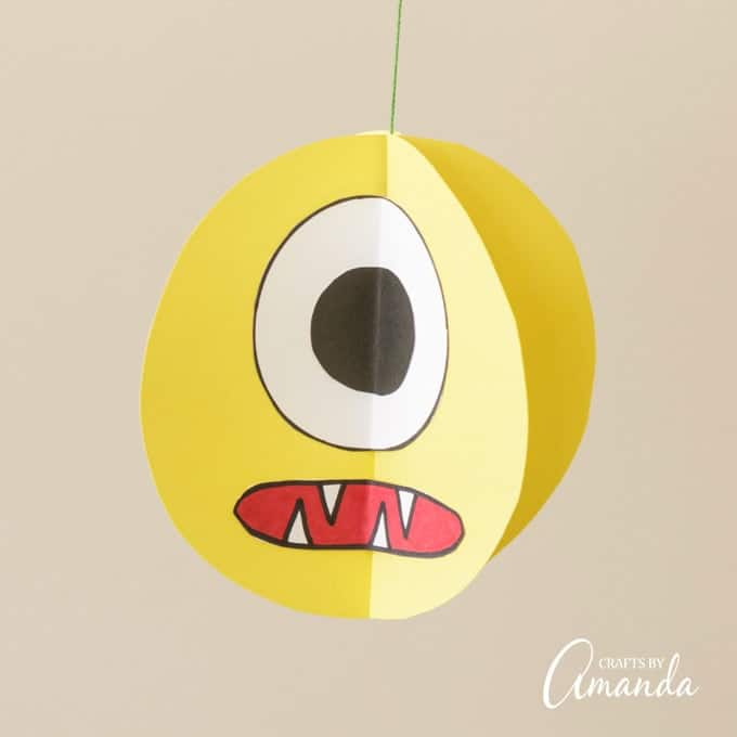 If your kids love monsters, they'll have a blast making these twirling paper monsters for their monster themed birthday or a Halloween party!