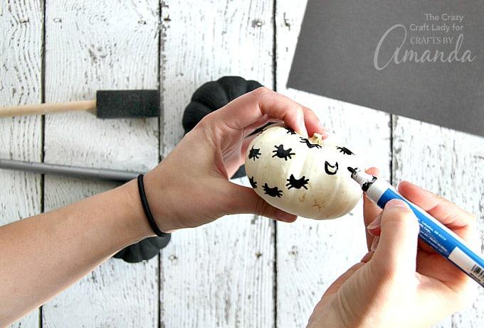 Black Cat Pumpkins step 3 drawing on the pumpkin