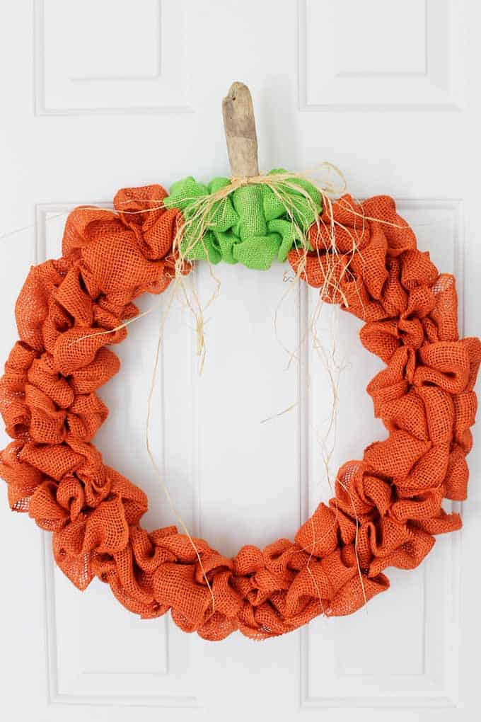 Make a burlap pumpkin wreath for your front door this fall!