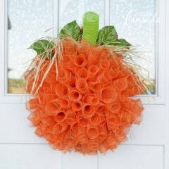 Make this wonderful deco mesh pumpkin wreath to hang on your door this fall!