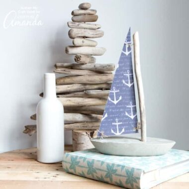 While you won't want to try floating it, this DIY concrete and driftwood sailboat is a breezy nautical or coastal decor idea for your home or cottage.