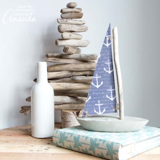 nautical themed sailboat made from concrete and driftwood