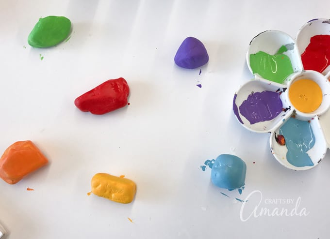 Paint each rock in desired color. Let them dry then add a second coat. Let them dry completely.