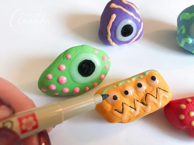 Once the glow in the dark paint is dry enough that it has a solid surface, use a black marker to add the eyeballs.