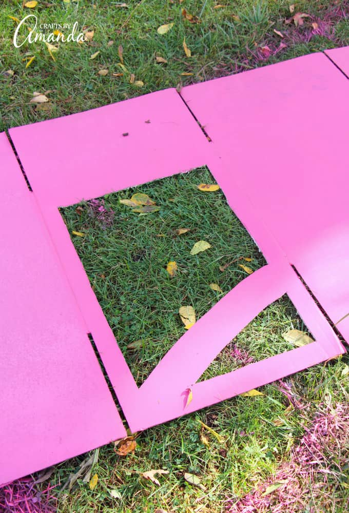 cutting out a window on a pink box